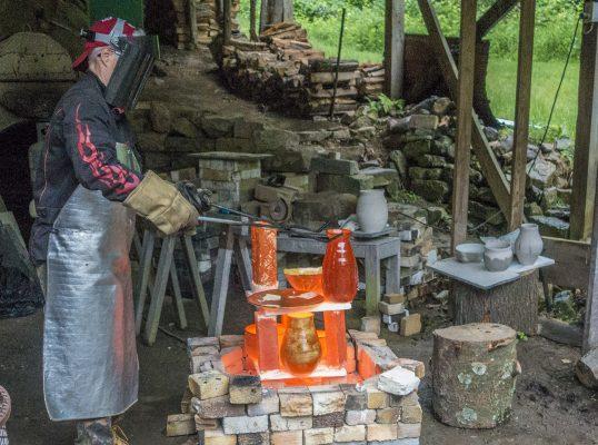 Lisa pulling the red-hot pots Raku firing